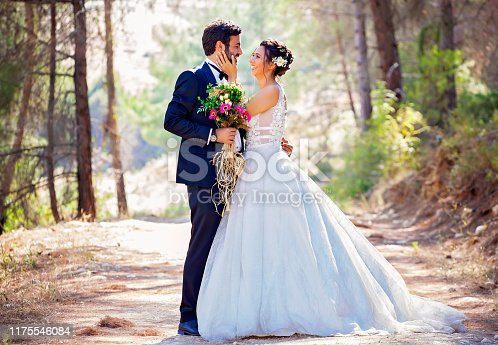 Portrait of happy bride and groom outdoor in nature.