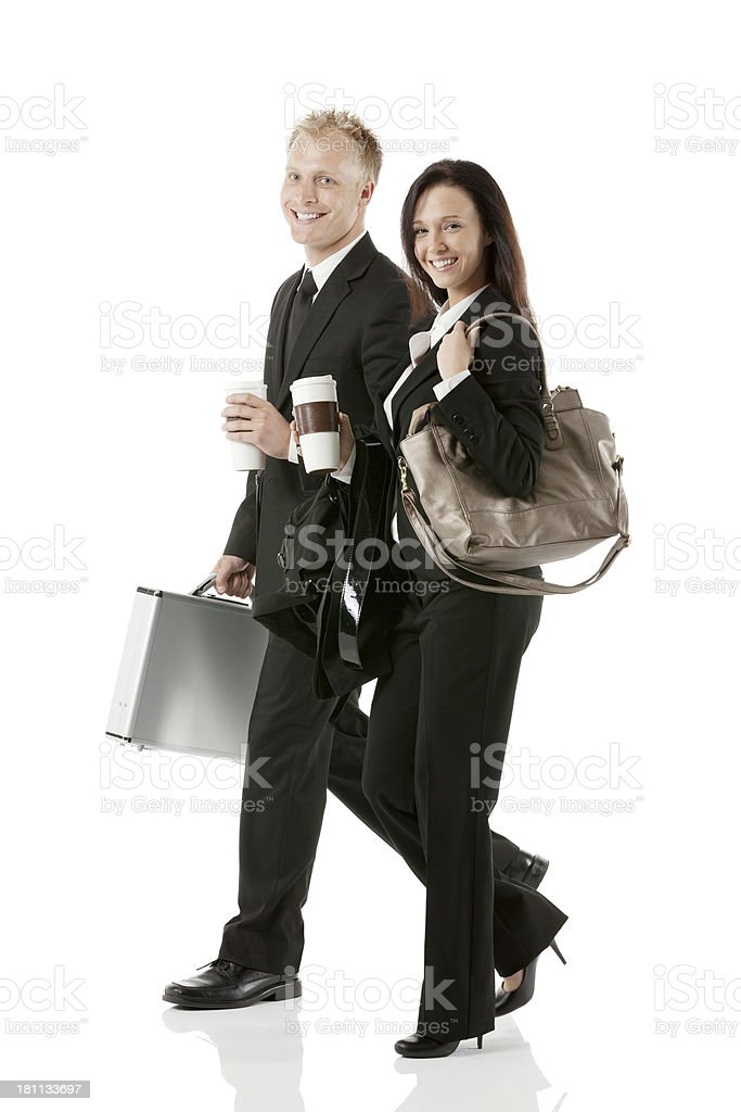 Portrait of happy business couple walking together royalty-free stock photo