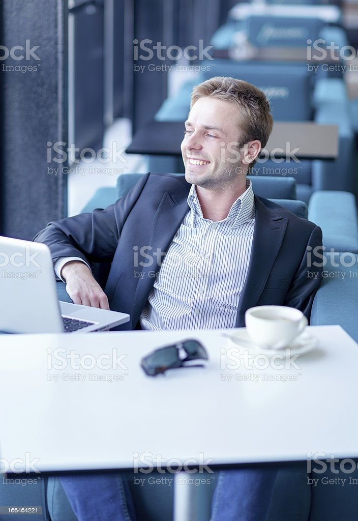 Portrait of happy business man at the window stock photo