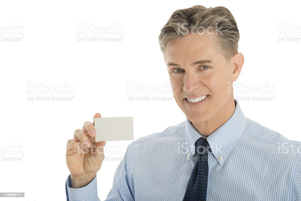 Portrait Of Happy Businessman Showing Blank Card royalty-free stock photo