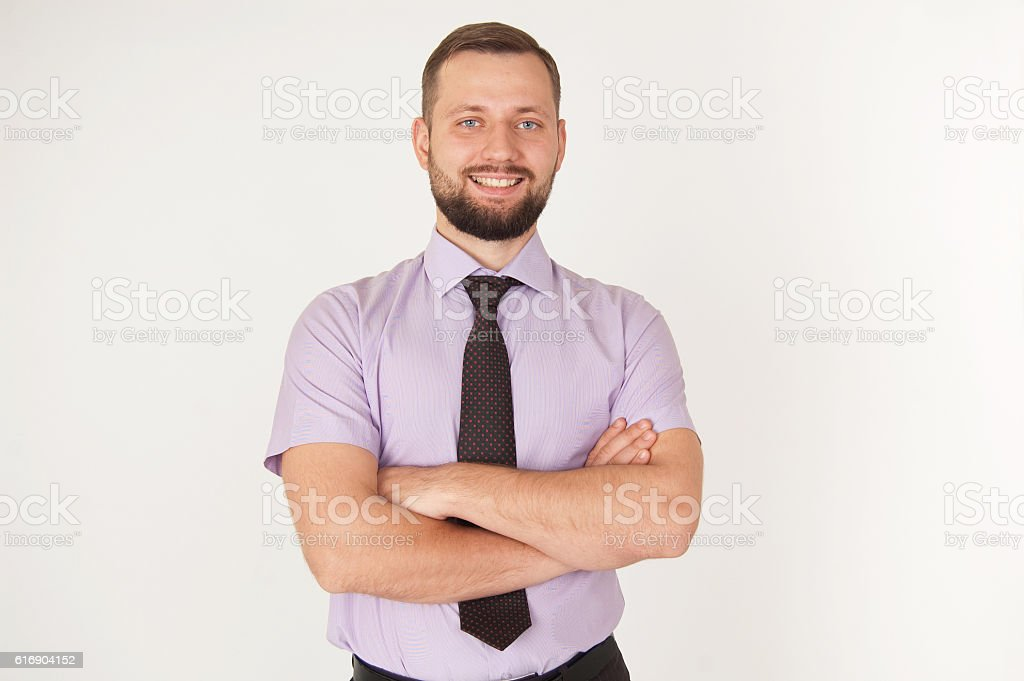 Portrait of happy businessman with crossed hands stock photo