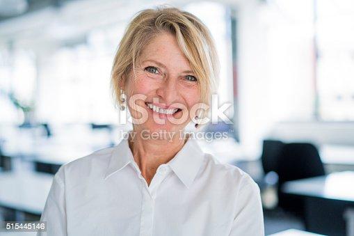 istock Portrait of happy businesswoman in office 515445146