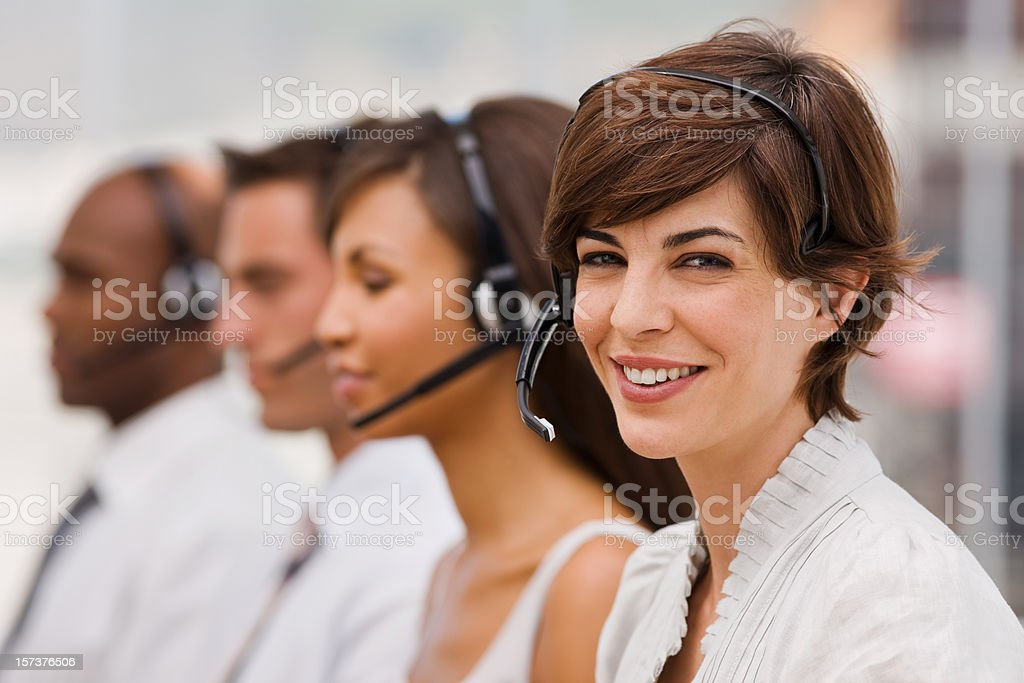 Portrait of happy call center employees with headset royalty-free stock photo