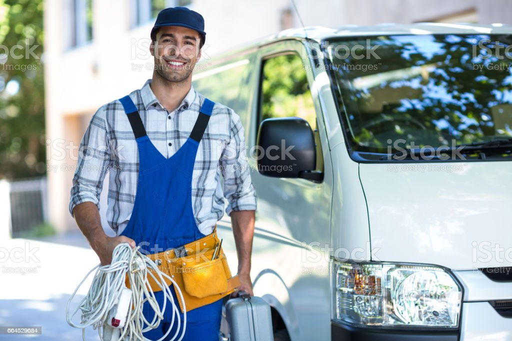 Portrait of happy carpenter with toolbox royalty-free stock photo