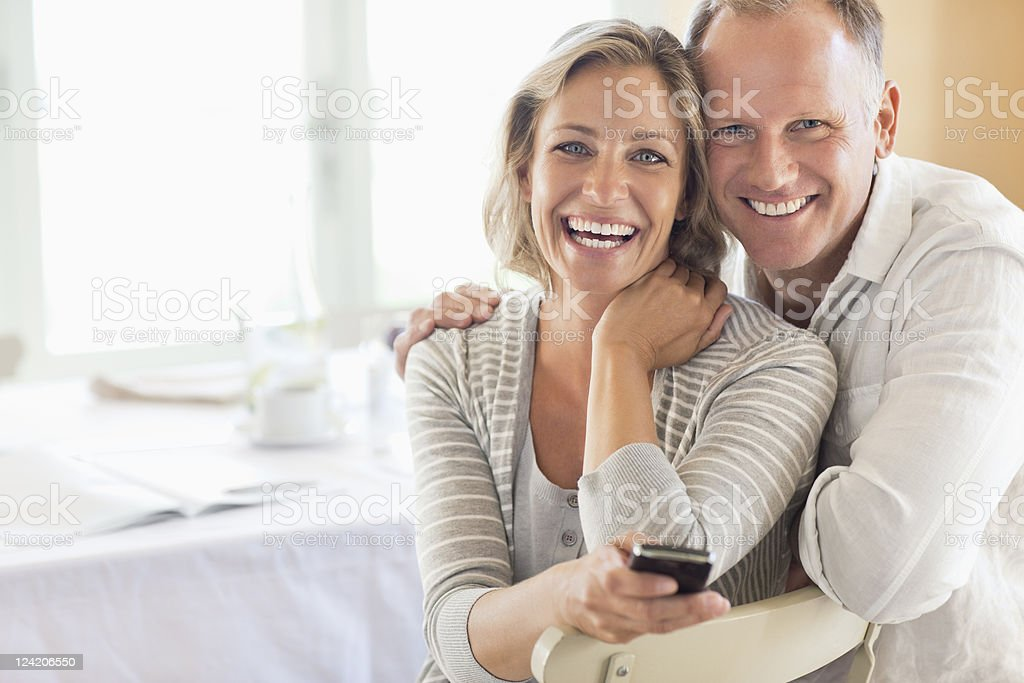 Portrait of happy couple at the breakfast table stock photo
