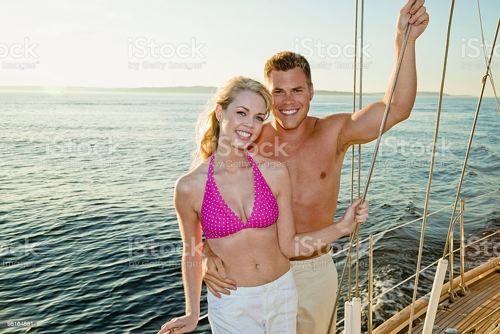 Portrait of happy couple on sailboat royalty-free 스톡 사진
