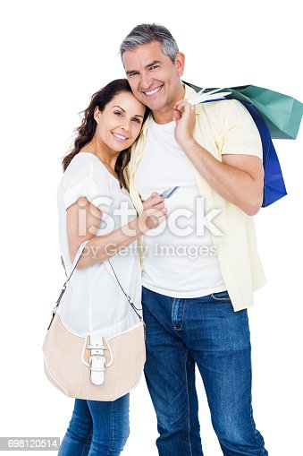istock Portrait of happy couple with shopping bags and credit card 698120514