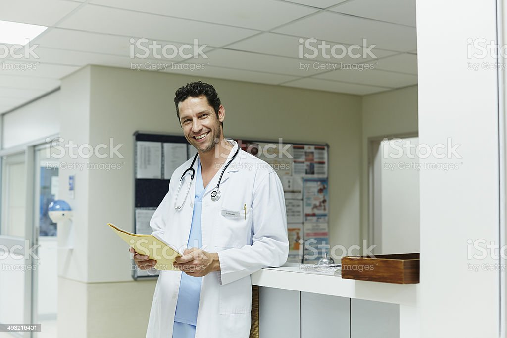 Portrait of happy doctor in hospital stock photo