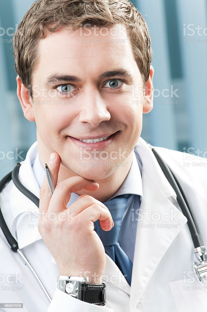 Portrait of happy doctor with pen at office royalty-free stock photo