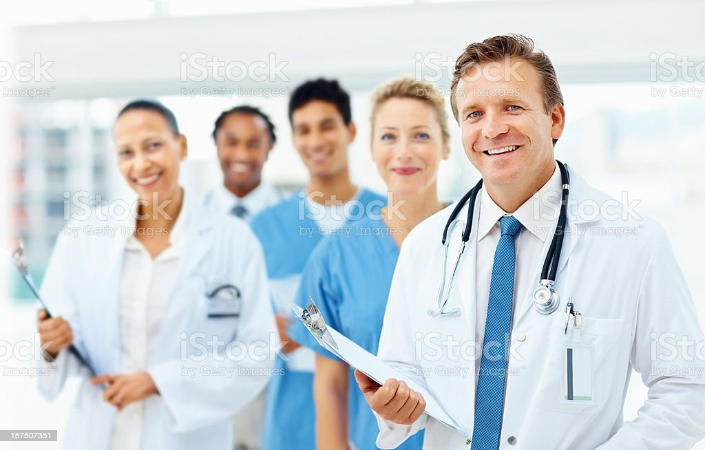 Portrait of happy doctors standing together stock photo