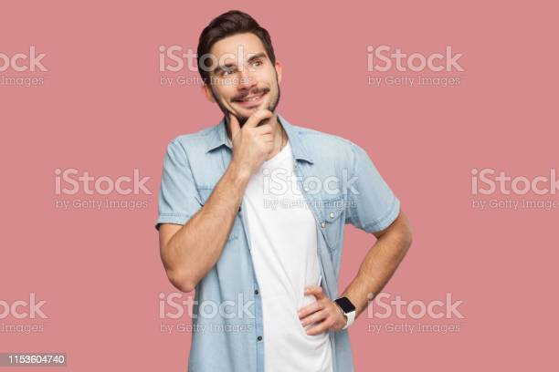 Portrait of happy dreamy handsome bearded young man in blue casual picture id1153604740?b=1&k=6&m=1153604740&s=612x612&h=6dci1hpq riqietlyc5ijgpygofmj7el5nfajwe37bs=