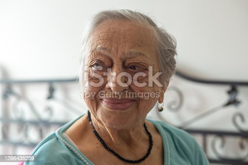 Portrait of happy elderly woman. Old age, beauty, skin, health, care, joy of life and 90s concepts. Horizontal close-up.