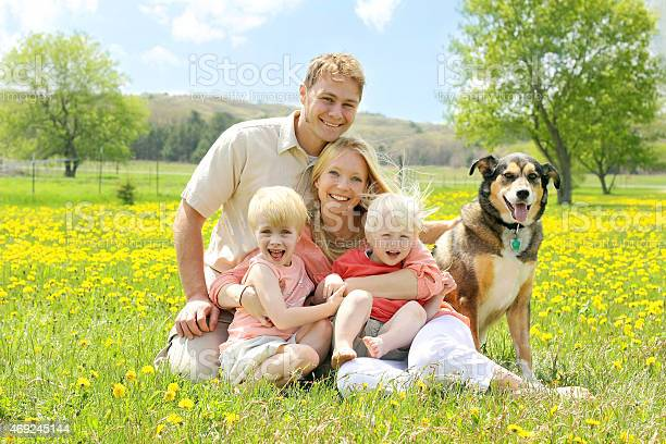 Portrait of happy family and dog in flower meadow picture id469245144?b=1&k=6&m=469245144&s=612x612&h=12zcy4gb1y2iasxiphzqkyddrdhitbn6bxh h au07k=