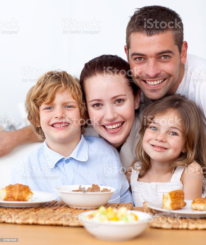 Portrait of happy family having breakfast royalty-free stock photo