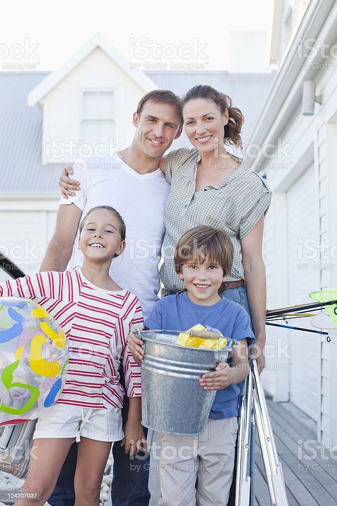 Portrait of happy family on vacation smiling and looking at the camera royalty-free stock photo