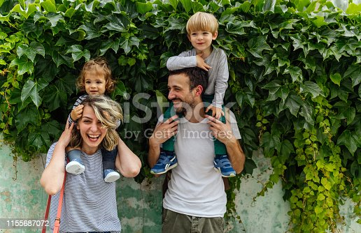 Portrait of happy family outdoors