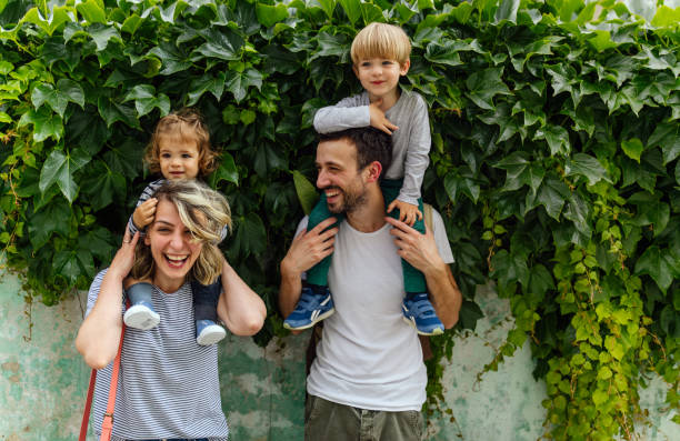 Portrait of happy family outdoors stock photo
