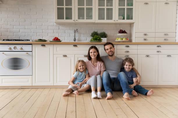 Portrait of happy family sitting on floor at kitchen picture id1174655407?b=1&k=6&m=1174655407&s=612x612&w=0&h=kcxo uwbeyccs93zhqbiir38cif5f8pzbyiboy4jkgk=