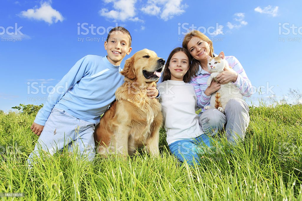 Portrait of happy family with cat and dog. royalty-free stock photo