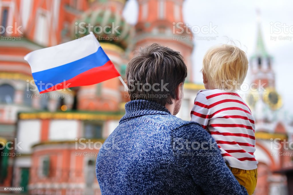 Portrait of happy family with russian flag stock photo