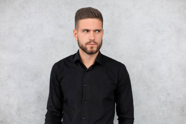 Portrait of happy fashionable handsome man in black shirt looking at camera Portrait of happy fashionable handsome man in black shirt looking at camera. black shirt stock pictures, royalty-free photos & images
