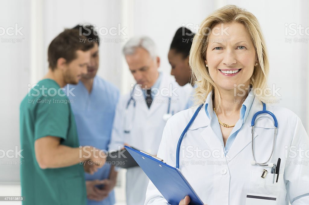 Portrait Of Happy Female Doctor stock photo