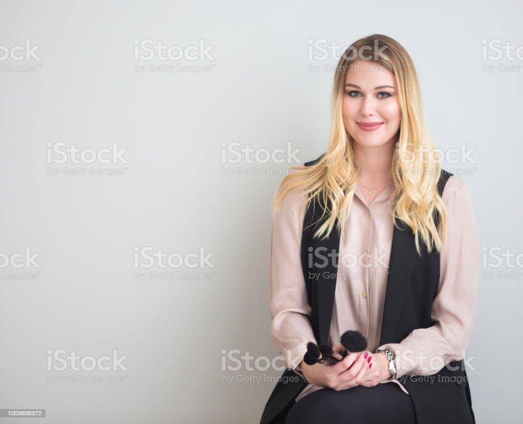 Portrait of happy female make up artist stock photo