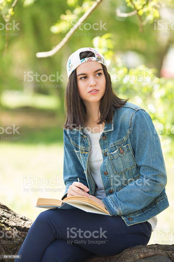 Portrait of happy female student stock photo
