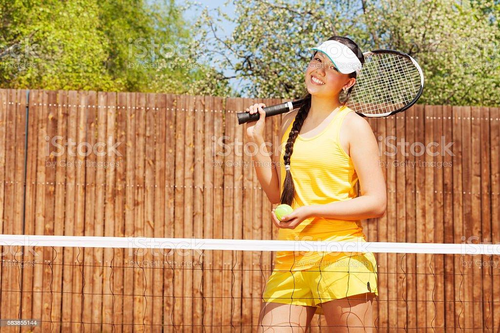 Portrait of happy female tennis player stock photo