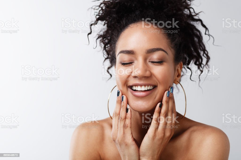 Portrait of happy female with her eyes closed stock photo