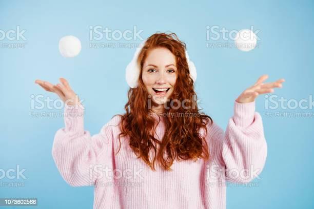 Portrait of happy girl throwing snowball picture id1073602566?b=1&k=6&m=1073602566&s=612x612&h=kgwbg7xdbe1g5lhdg8jvmo ynfcsmuuv cz6 69 v k=