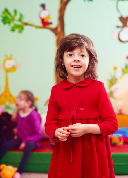 portrait of happy girl with disability at rehabilitation center for kids with special needs - foto stock