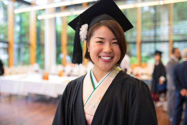 Portrait of happy graduate at graduation ceremony stock photo