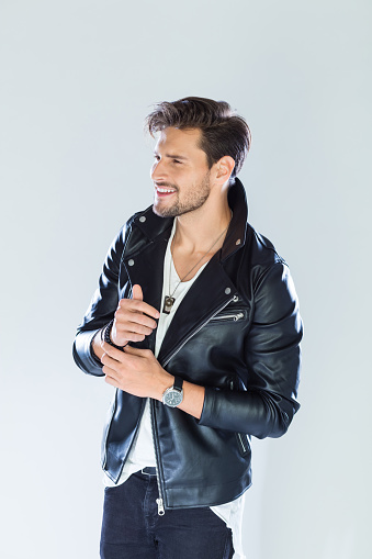 Portrait Of Happy Handsome Man Wearing Leather Jacket Stock Photo - Download Image Now