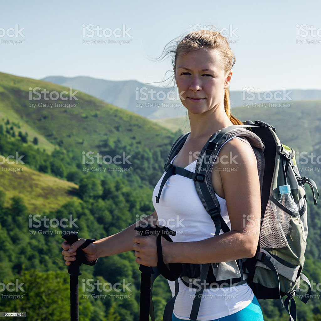 Portrait of happy hiking female stock photo