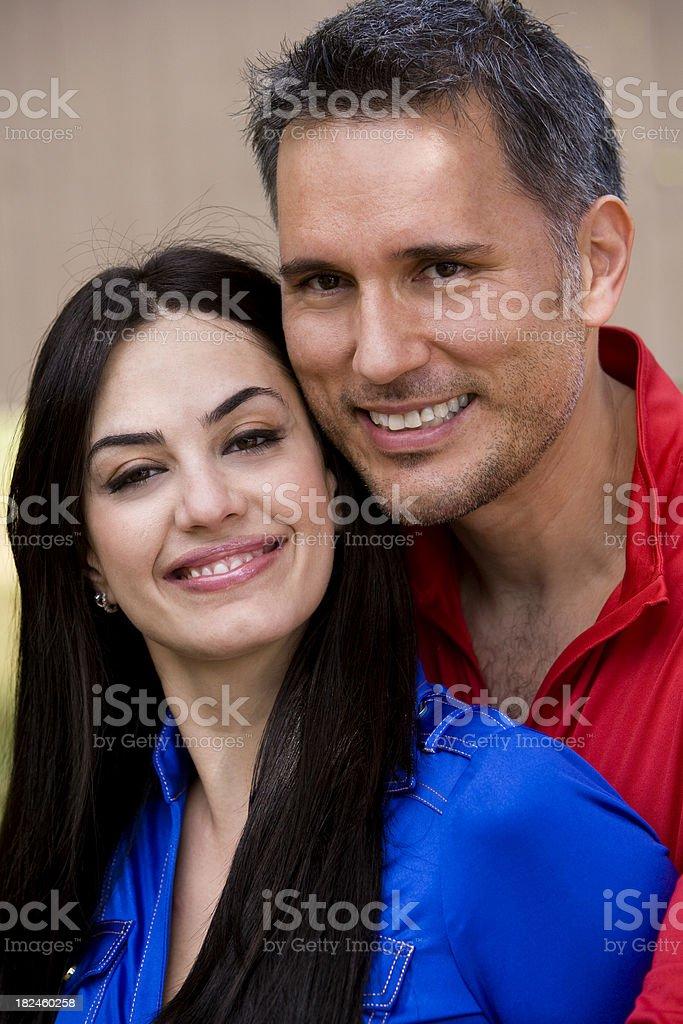 Portrait of happy hispanic couple looking at camera royalty-free stock photo