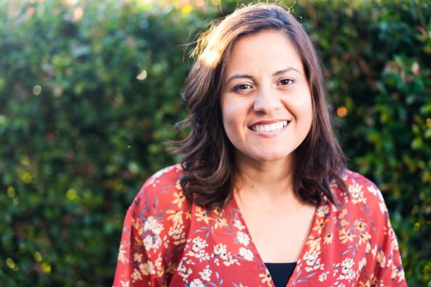 Portrait of happy Hispanic woman. stock photo