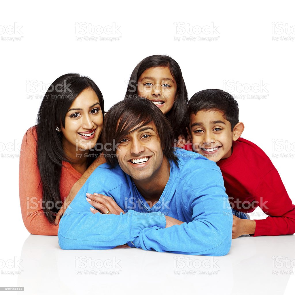 Portrait of happy Indian family lying on floor royalty-free stock photo