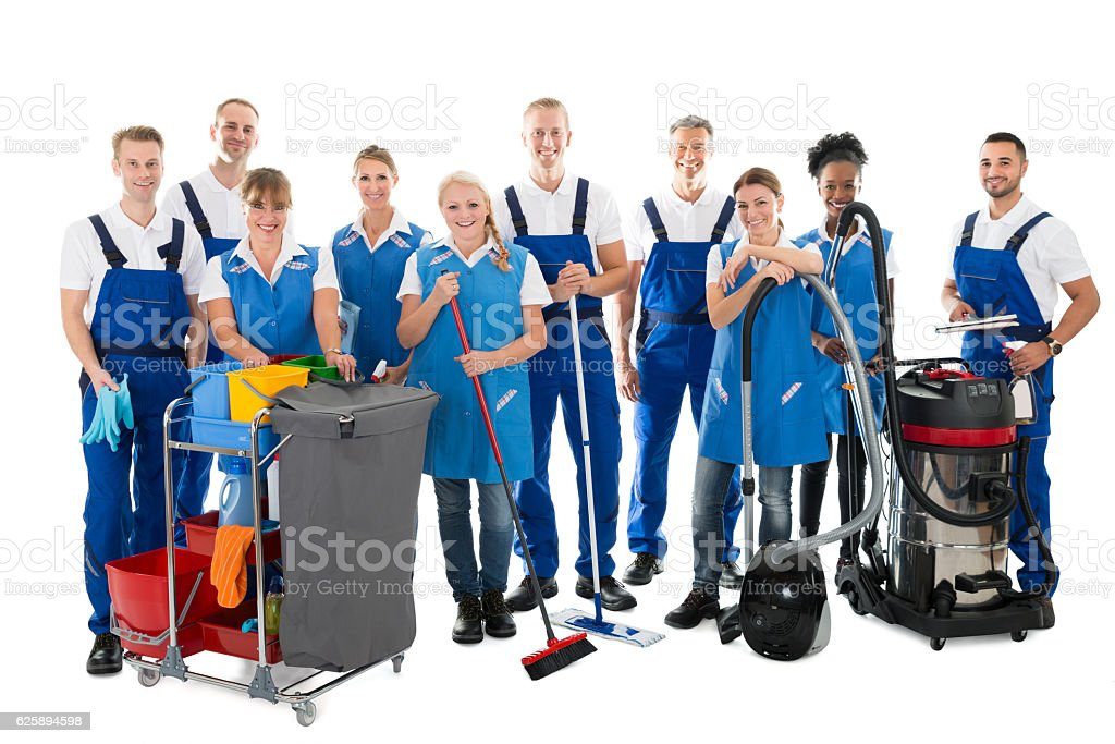 Portrait Of Happy Janitors With Cleaning Equipment stock photo
