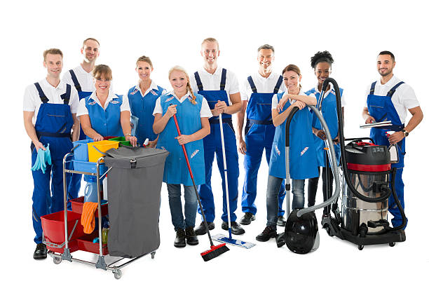 portrait of happy janitors with cleaning equipment - custodian stock pictures, royalty-free photos & images
