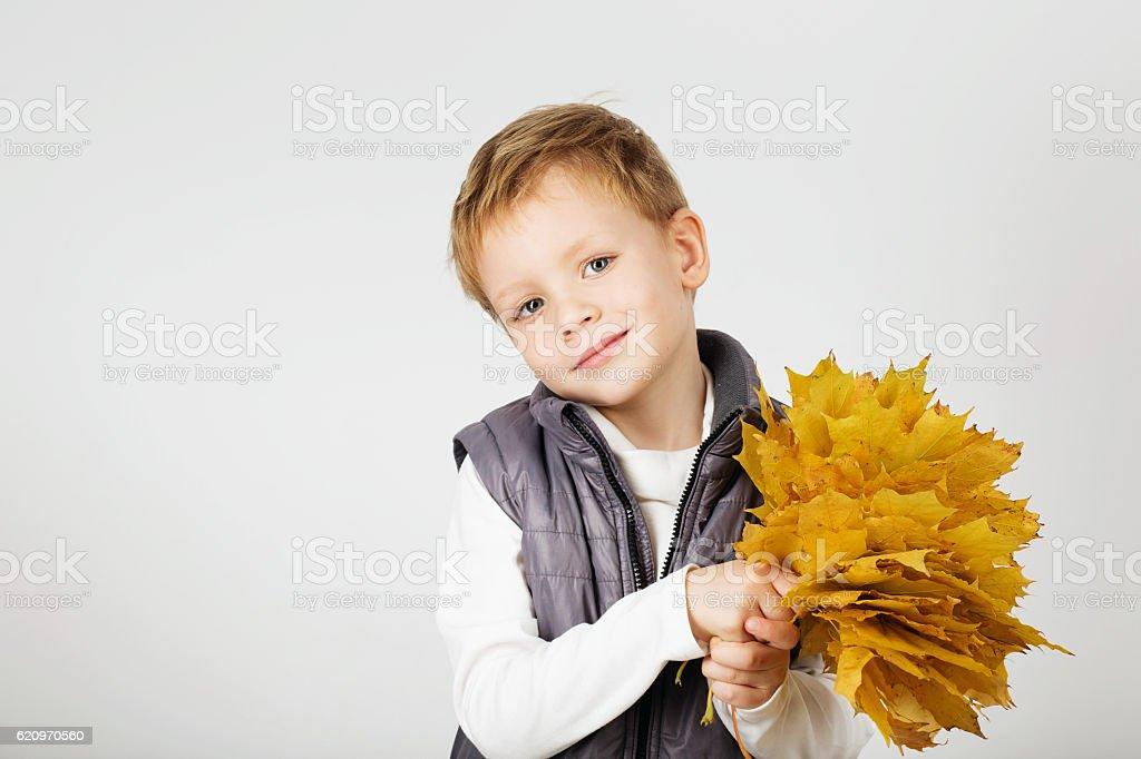 Portrait of happy joyful beautiful little boy against white back stock photo