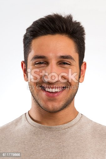 492529287istockphoto Portrait of Happy Laughing Man 611779866