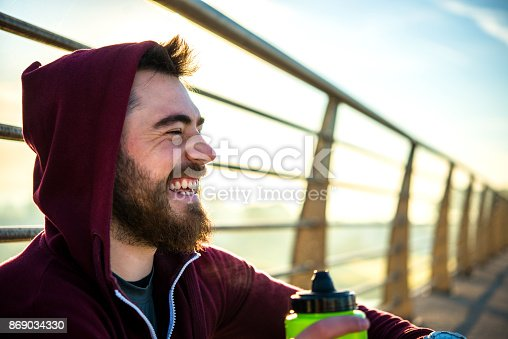 492529287istockphoto Portrait Of Happy Laughing Man 869034330