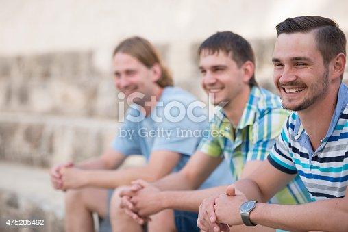 istock Portrait of happy laughing men. 475205462