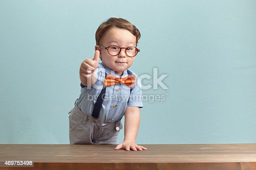 istock Portrait of happy little boy giving you thumbs up 469753498