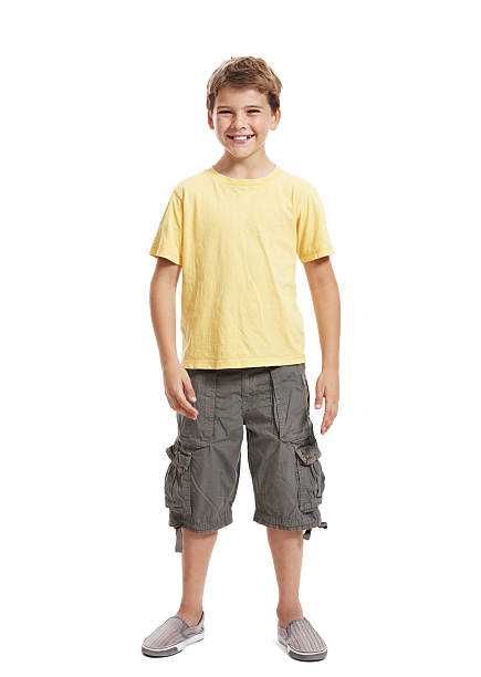 Portrait of happy, little boy standing isolated on white background stock photo