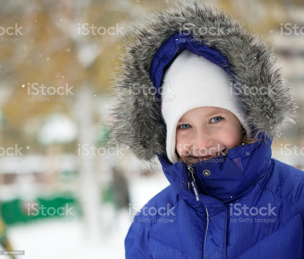 Portrait of happy little girl in winter time. Lizenzfreies stock-foto