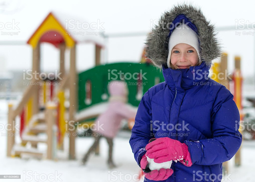 Portrait of happy little girl in winter time. foto stock royalty-free