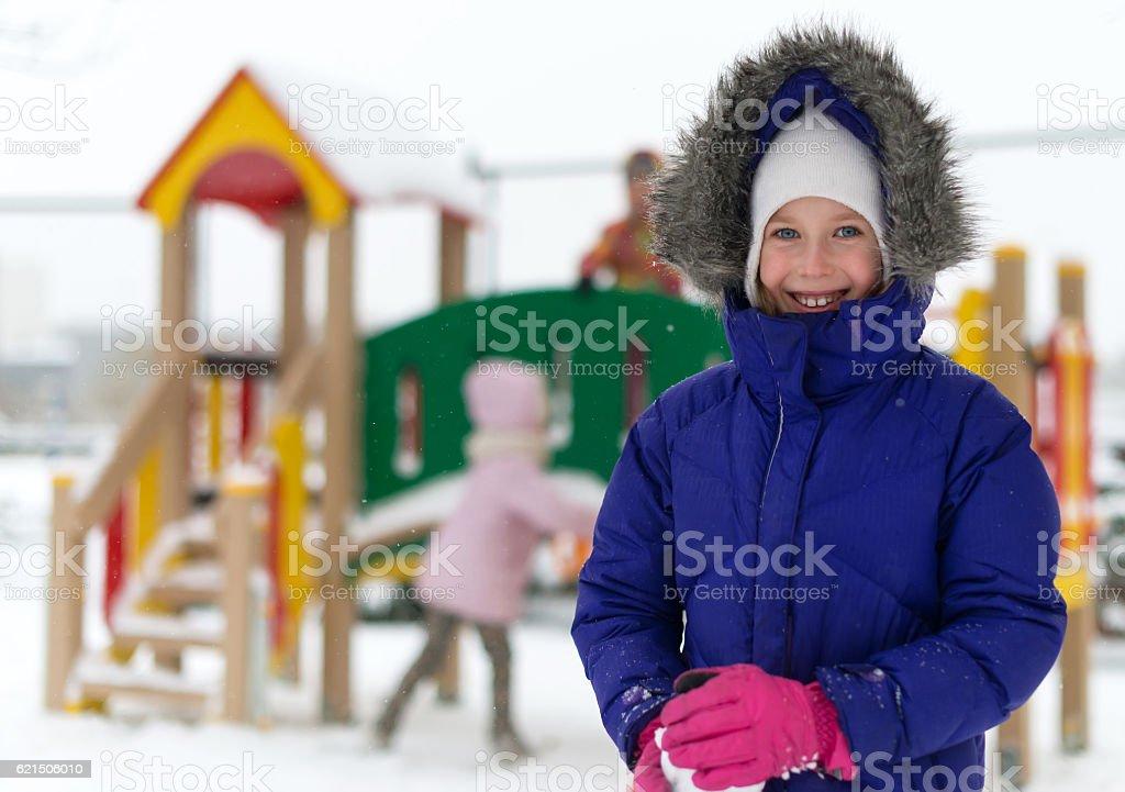 Portrait of happy little girl in winter time. Lizenzfreies stock-foto