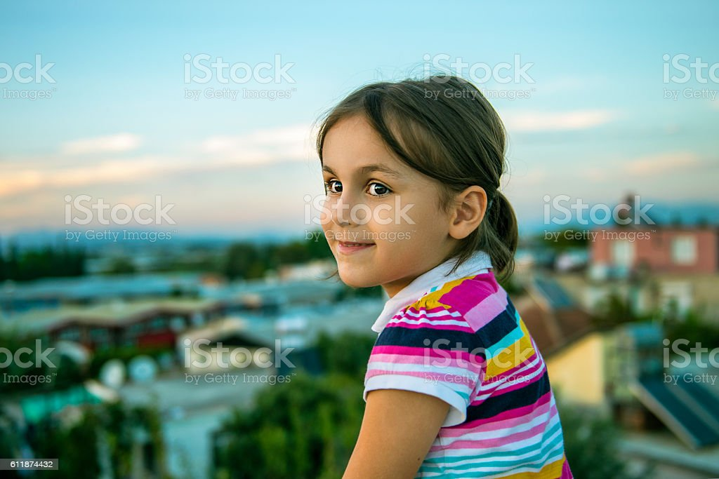 Portrait of happy little girl looking away with content smile stock photo